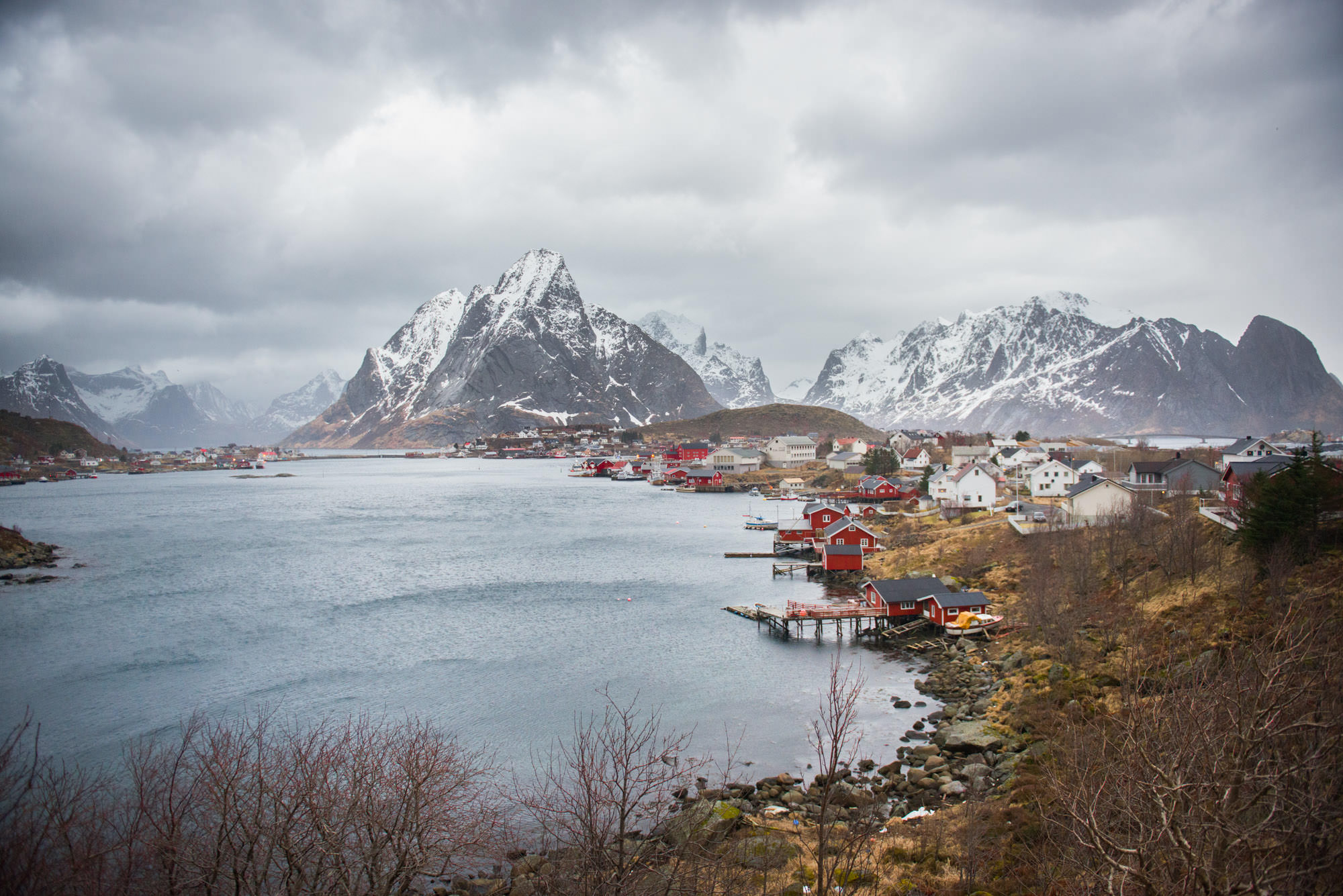 A fishing village with small red houses on the coast in Norway