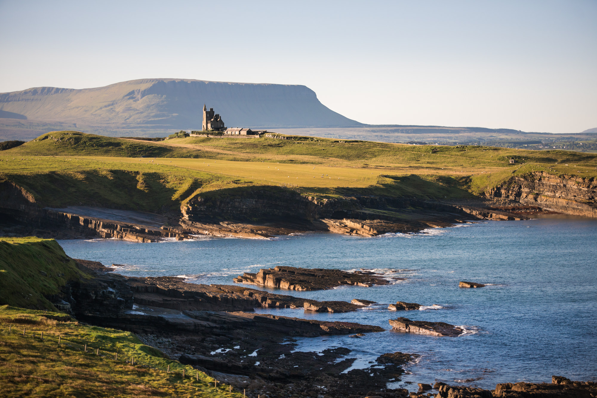 Classiebawn Castle on the coast at sunrise