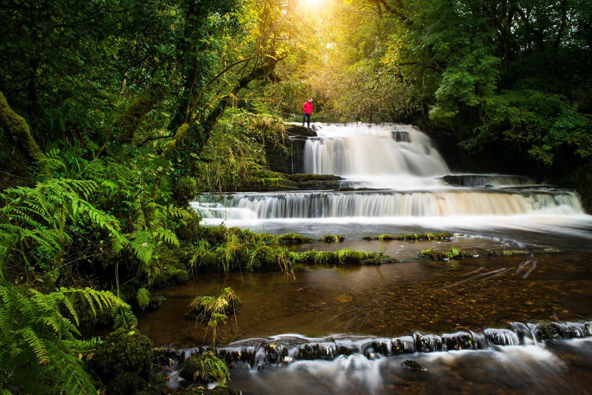 A man standing above Fowley Falls