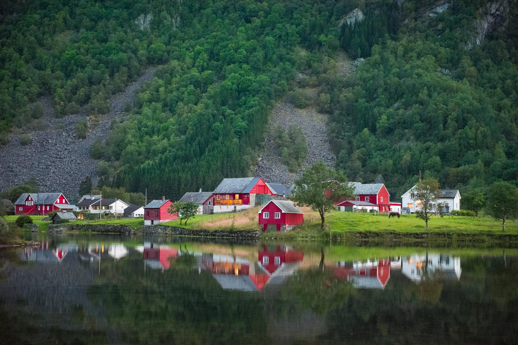 A beautiful Norwegian farm reflecting in a lake