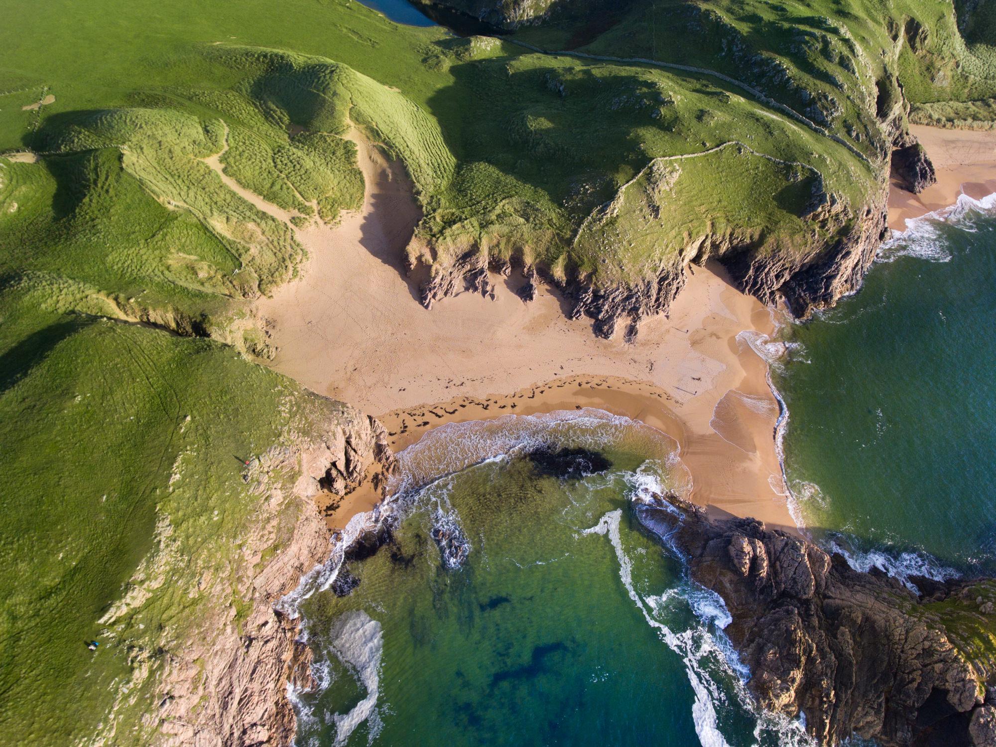 Aerial image of Murder Hole Cove beach in Ireland