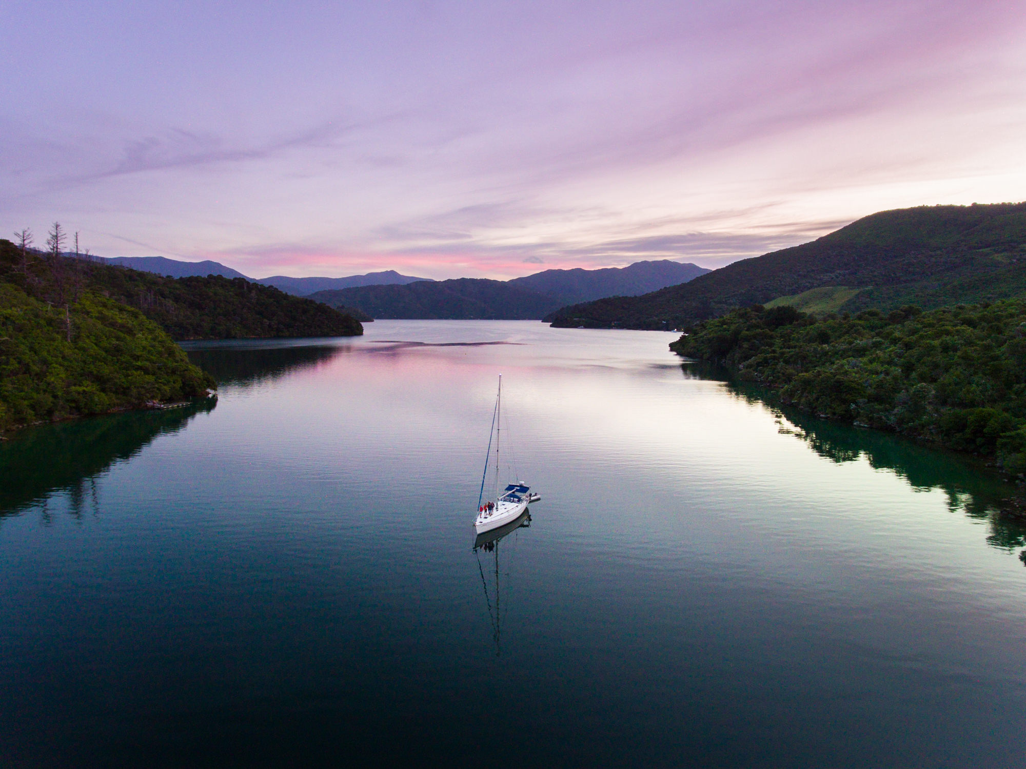 Aerial of boat in bay at Marlborough Sound sunset