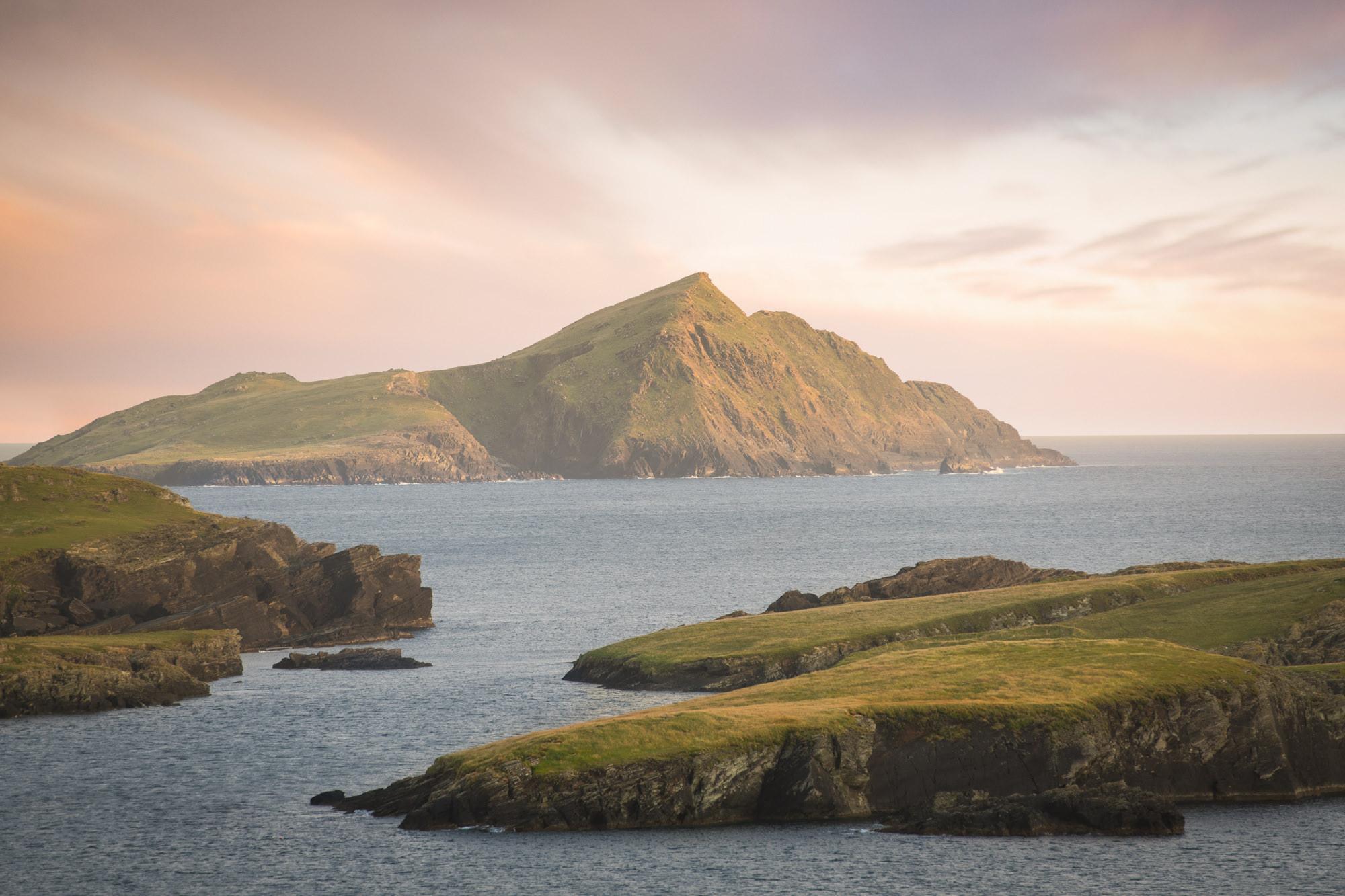 Sunset over a dramatic coastline in ireland